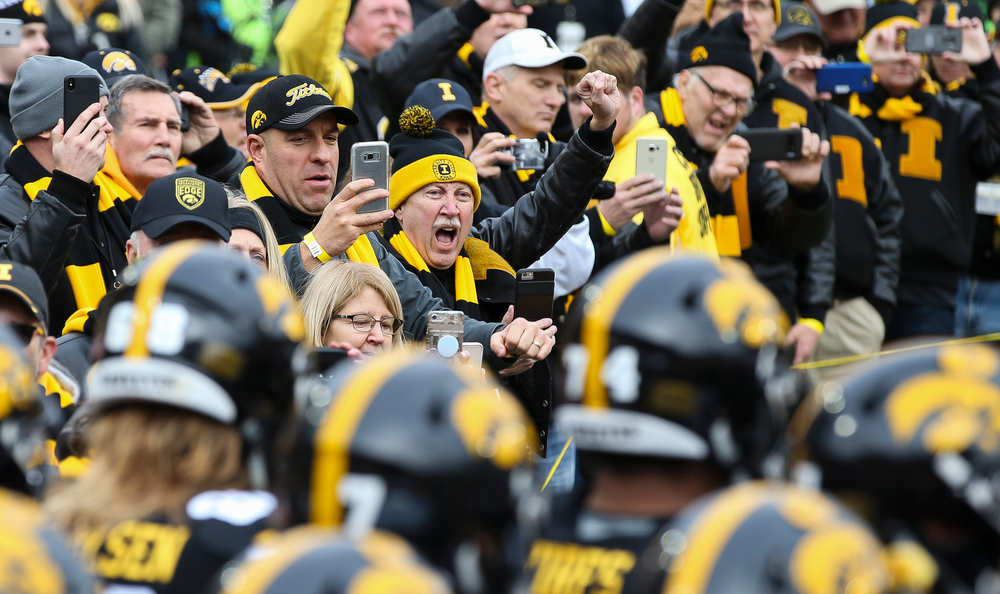Former Hawkeye All-Americans form a tunnel for The Swarm before a game against Nebraska at Kinnick Stadium on November 23, 2018. (Tork Mason/hawkeyesports.com)