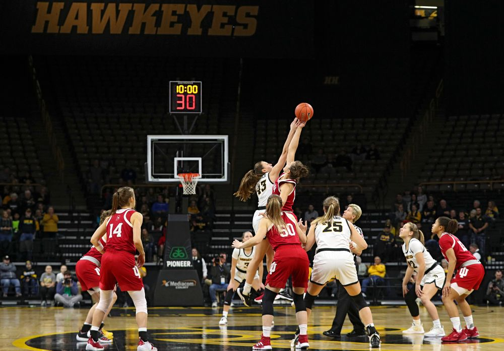 Iowa Hawkeyes forward Amanda Ollinger (43) wins the opening tip off during the first quarter of their game at Carver-Hawkeye Arena in Iowa City on Sunday, January 12, 2020. (Stephen Mally/hawkeyesports.com)