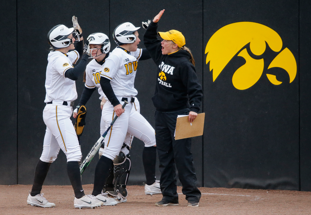 Iowa Hawkeyes outfielder Allie Wood (17), Iowa Hawkeyes infielder Mallory Killian (11), Iowa Hawkeyes assistant coach Rachel West