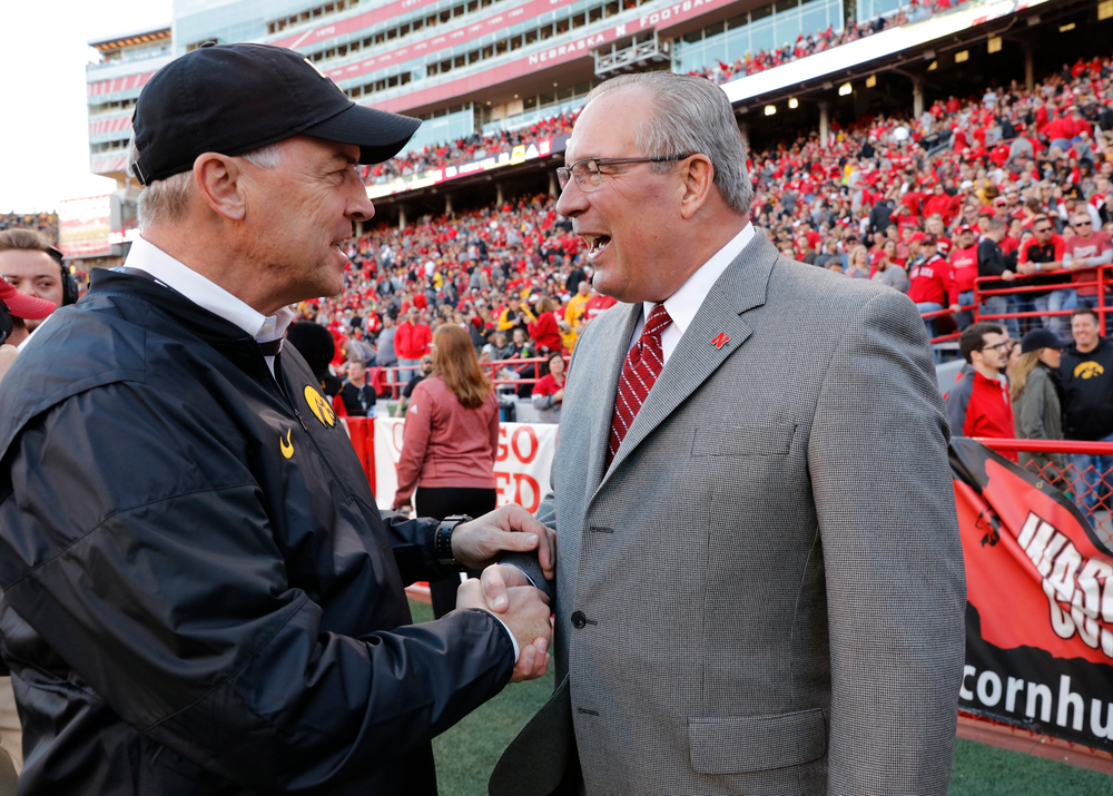Iowa Hawkeyes Director of Athletics Gary Barta and Nebraska Athletics Director Bill Moos
