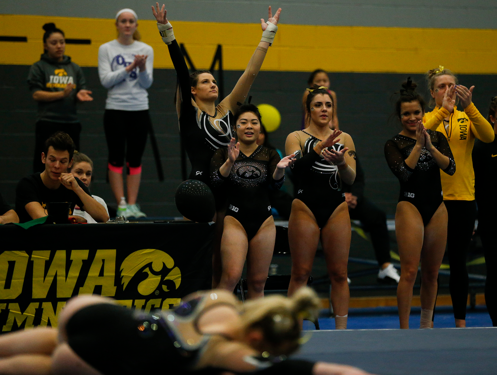 Iowa gymnasts react during Charlotte Sullivan's floor routine during the Black and Gold Intrasquad meet at the Field House on 12/2/17. (Tork Mason/hawkeyesports.com)
