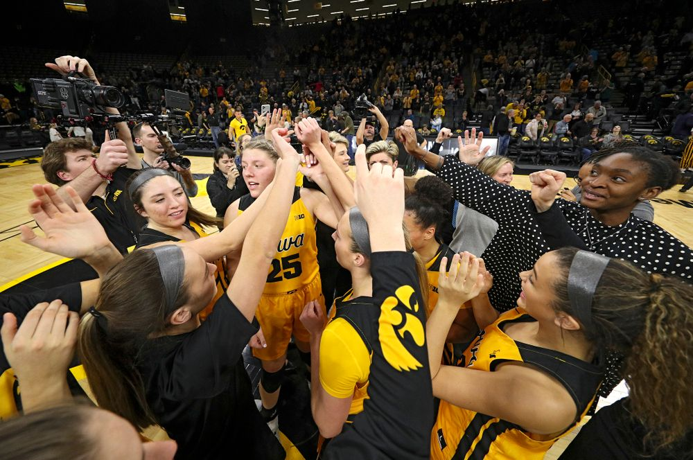 The Hawkeyes huddle after winning their game at Carver-Hawkeye Arena in Iowa City on Thursday, January 23, 2020. (Stephen Mally/hawkeyesports.com)