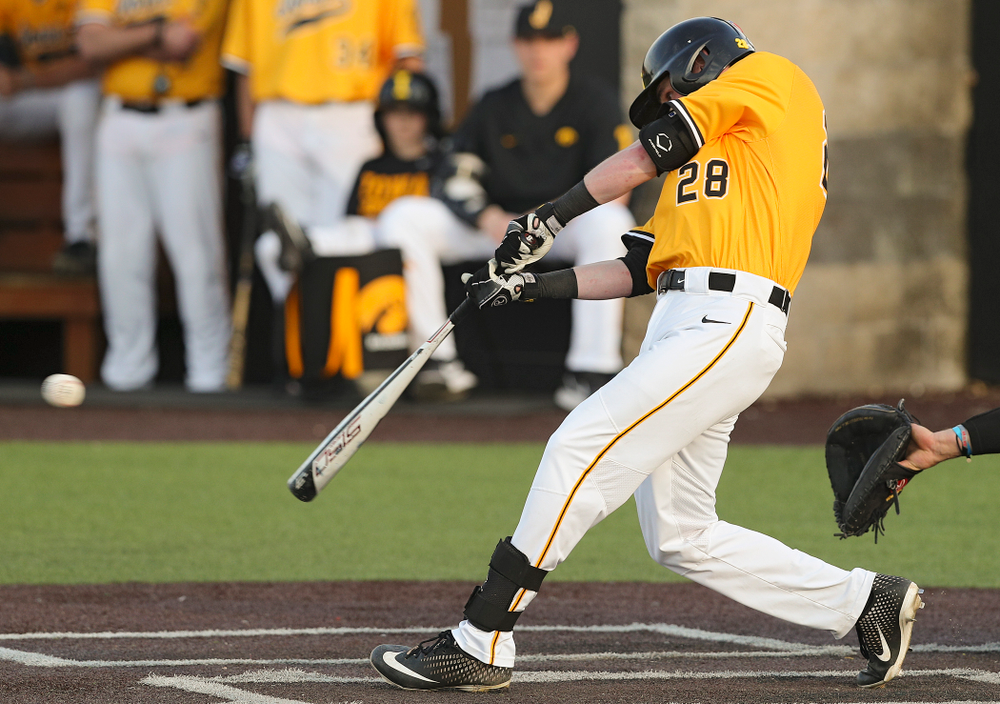 Iowa Hawkeyes left fielder Chris Whelan (28) gets a hit during the sixth inning of their game against Northern Illinois at Duane Banks Field in Iowa City on Tuesday, Apr. 16, 2019. (Stephen Mally/hawkeyesports.com)