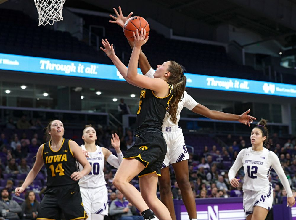 Iowa Hawkeyes forward Amanda Ollinger (43) scores a basket during the third quarter of their game at Welsh-Ryan Arena in Evanston, Ill. on Sunday, January 5, 2020. (Stephen Mally/hawkeyesports.com)