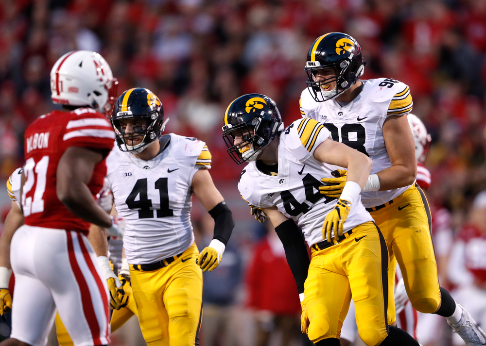 Iowa Hawkeyes linebacker Ben Niemann (44) and defensive end Anthony Nelson (98)