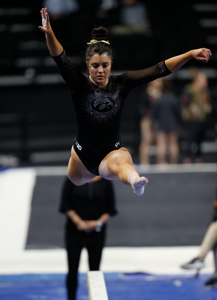 Nikki Youd competes on the beam