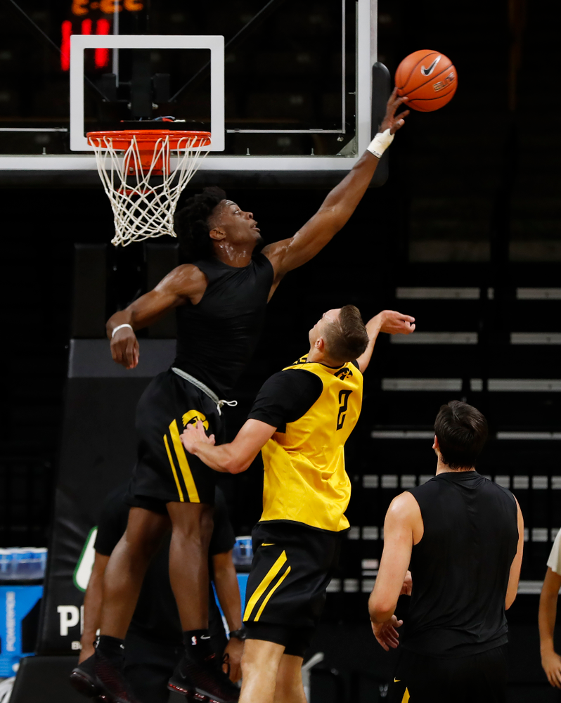 Iowa Hawkeyes forward Tyler Cook (25) blocks a shot during the first practice of the season Monday, October 1, 2018 at Carver-Hawkeye Arena. (Brian Ray/hawkeyesports.com)