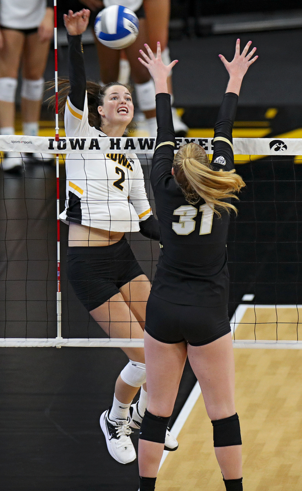 Iowa's Courtney Buzzerio (2) goes up for a kill during the first set of their Big Ten/Pac-12 Challenge match against Colorado at Carver-Hawkeye Arena in Iowa City on Friday, Sep 6, 2019. (Stephen Mally/hawkeyesports.com)