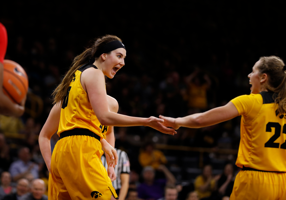 Iowa Hawkeyes forward Megan Gustafson (10) and Kathleen Doyle