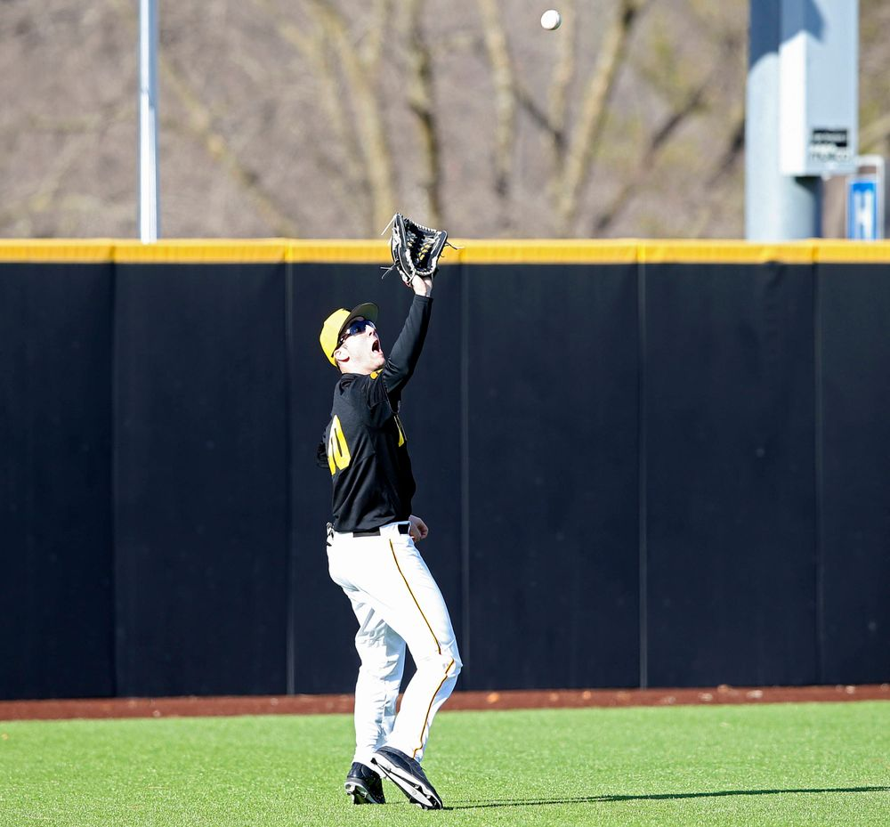 Iowa Hawkeyes left fielder Connor McCaffery (30) tracks down a fly ball for the final out of the ninth inning of their game against Illinois at Duane Banks Field in Iowa City on Saturday, Mar. 30, 2019. (Stephen Mally/hawkeyesports.com)