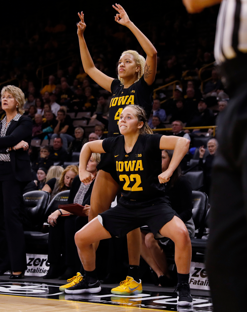 Iowa Hawkeyes guard Kathleen Doyle (22) and forward Chase Coley (4)