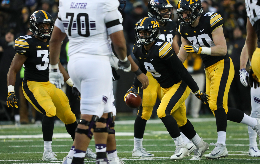 Iowa Hawkeyes defensive back Geno Stone (9) reacts after intercepting a pass during a game against Northwestern at Kinnick Stadium on November 10, 2018. (Tork Mason/hawkeyesports.com)