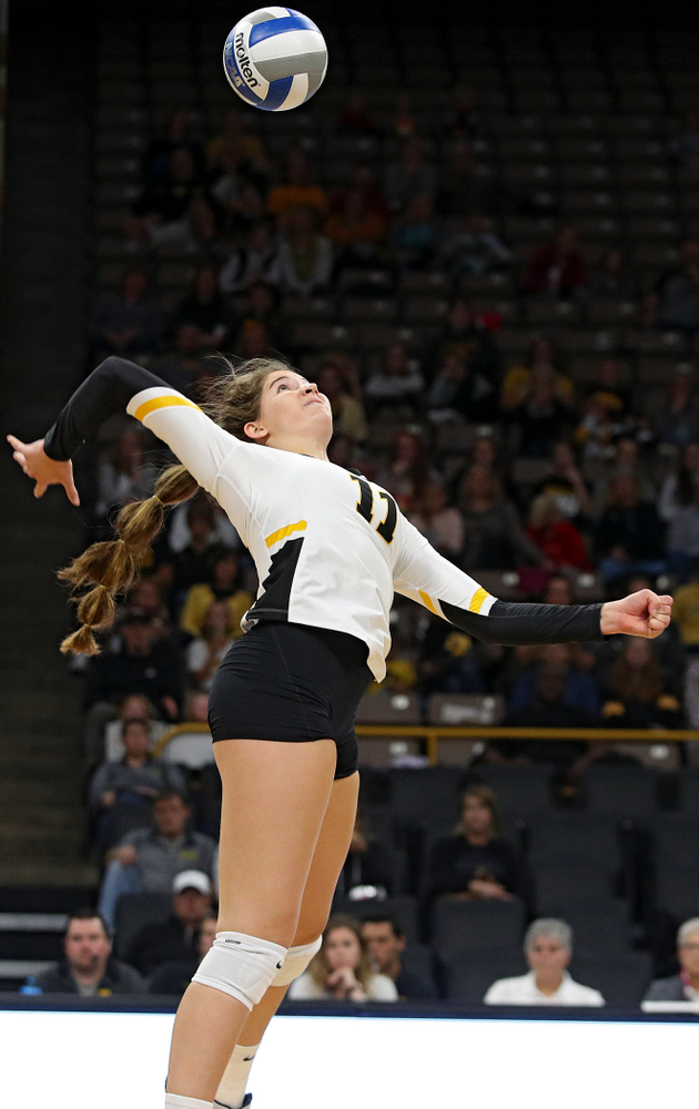 Iowa's Blythe Rients (11) lines up a shot during the second set of their volleyball match at Carver-Hawkeye Arena in Iowa City on Sunday, Oct 13, 2019. (Stephen Mally/hawkeyesports.com)
