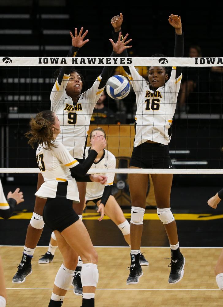 Iowa Hawkeyes middle blocker Amiya Jones (9), Iowa Hawkeyes outside hitter Taylor Louis (16)
