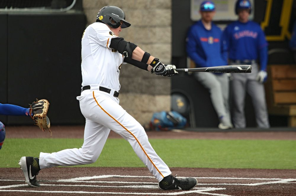 Iowa first baseman Peyton Williams (45) hits a double during the first inning of their college baseball game at Duane Banks Field in Iowa City on Wednesday, March 11, 2020. (Stephen Mally/hawkeyesports.com)