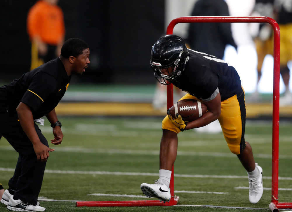 Iowa Hawkeyes running back Kyshaun Bryan (16) and running backs coach Derrick Foster during spring practice Wednesday, March 28, 2018 at the Hansen Football Performance Center.  (Brian Ray/hawkeyesports.com)