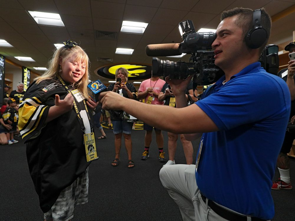 Kid Captain Kendra Hines is interviewed in the Iowa locker room during Kids Day at Kinnick Stadium in Iowa City on Saturday, Aug 10, 2019. (Stephen Mally/hawkeyesports.com)
