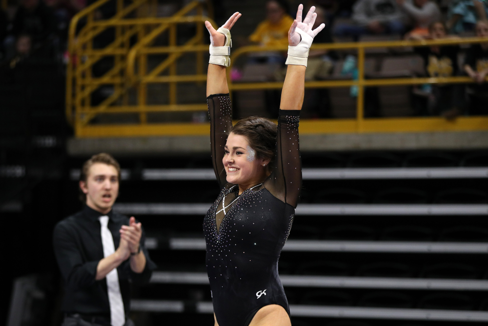 Iowa's Erin Castle competes on the vault against Illinois Saturday, February 16, 2019 at Carver-Hawkeye Arena. (Brian Ray/hawkeyesports.com)