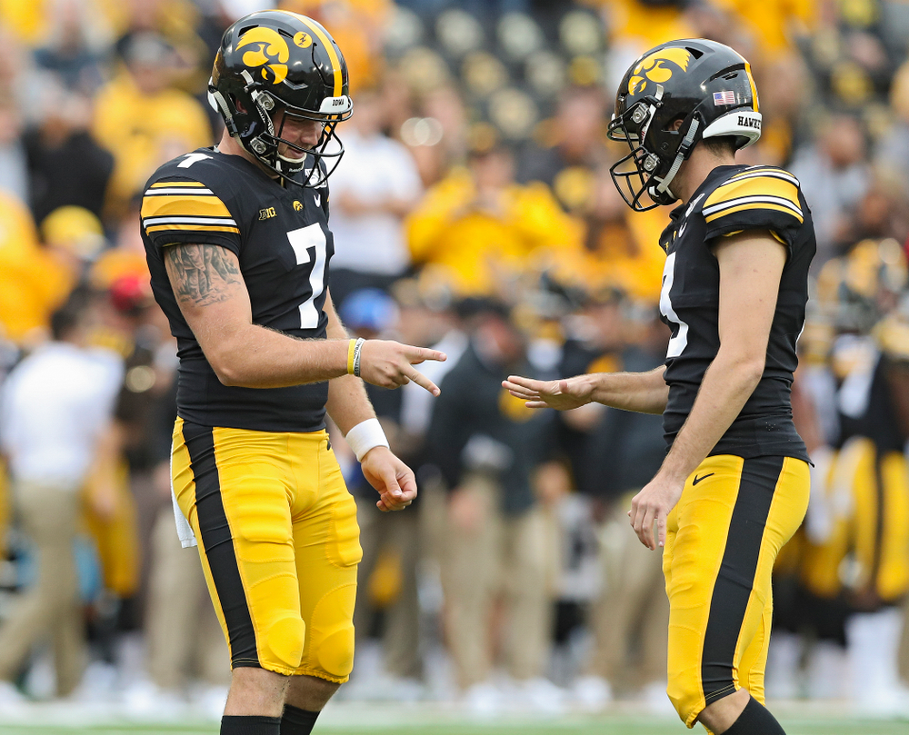 Iowa Hawkeyes punter Colten Rastetter (7) and Iowa Hawkeyes place kicker Keith Duncan (3) play rock-paper-scissors after Duncan made an extra point from the hold of Rastetter during fourth quarter of their game at Kinnick Stadium in Iowa City on Saturday, Sep 28, 2019. (Stephen Mally/hawkeyesports.com)