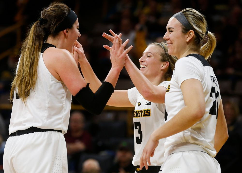Iowa Hawkeyes forward Megan Gustafson (10), Iowa Hawkeyes guard Makenzie Meyer (3), Iowa Hawkeyes forward Hannah Stewart (21)