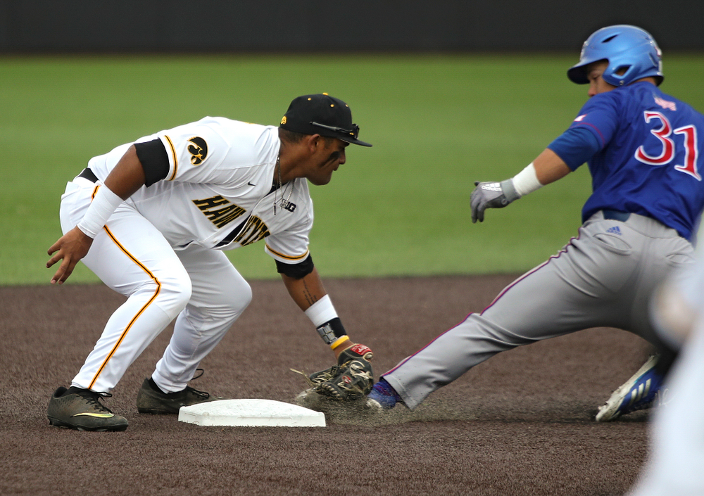 Iowa second baseman Izaya Fullard (20) tags out Kansas' Blaine Ray as he is caught stealing during the fourth inning of their college baseball game at Duane Banks Field in Iowa City on Wednesday, March 11, 2020. (Stephen Mally/hawkeyesports.com)