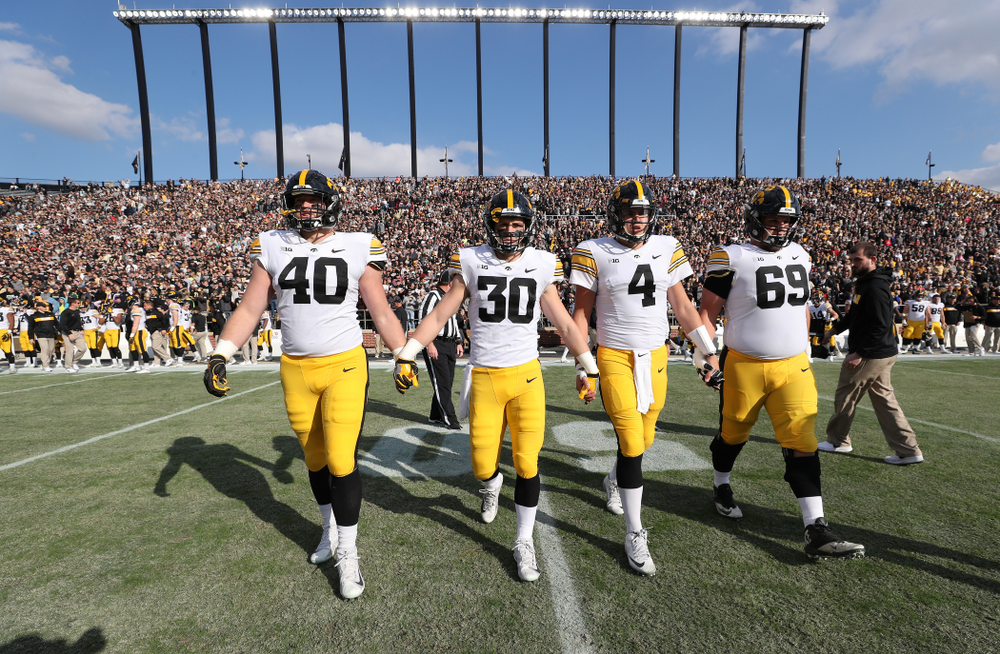 Iowa Hawkeyes captains defensive end Parker Hesse (40), defensive back Jake Gervase (30), quarterback Nate Stanley (4), and offensive lineman Keegan Render (69) against the Purdue Boilermakers Saturday, November 3, 2018 Ross Ade Stadium in West Lafayette, Ind. (Brian Ray/hawkeyesports.com)