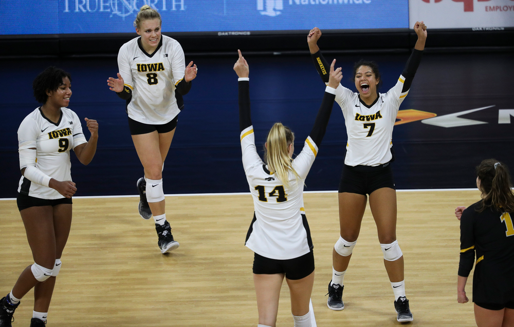 Iowa Hawkeyes middle blocker Amiya Jones (9), Iowa Hawkeyes right side hitter Reghan Coyle (8) and Iowa Hawkeyes setter Brie Orr (7) celebrate after winning a point during a match against Penn State at Carver-Hawkeye Arena on November 3, 2018. (Tork Mason/hawkeyesports.com)