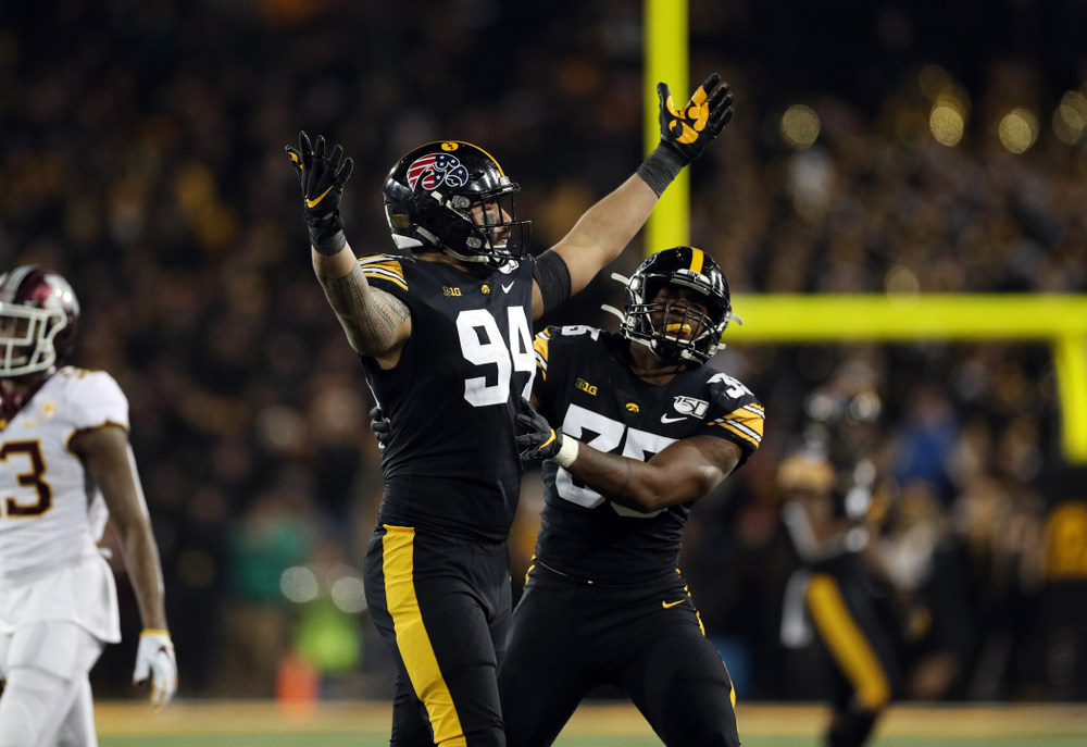 Iowa Hawkeyes defensive end A.J. Epenesa (94) celebrates a sack against the Minnesota Golden Gophers Saturday, November 16, 2019 at Kinnick Stadium. (Brian Ray/hawkeyesports.com)
