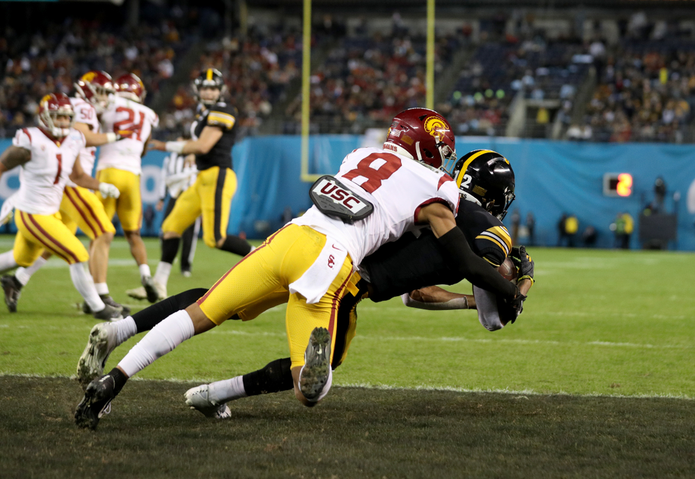 Iowa Hawkeyes wide receiver Brandon Smith (12) catches a touchdown pass against USC in the Holiday Bowl Friday, December 27, 2019 at San Diego Community Credit Union Stadium.  (Brian Ray/hawkeyesports.com)