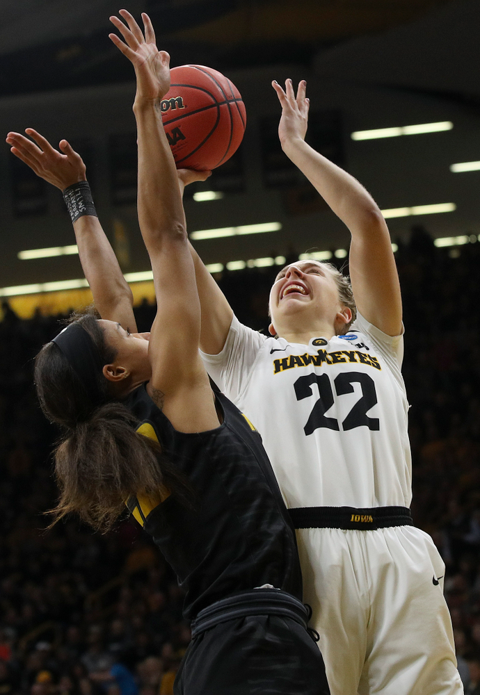Iowa Hawkeyes guard Kathleen Doyle (22) makes a basket during the first quarter of their second round game in the 2019 NCAA Women's Basketball Tournament at Carver Hawkeye Arena in Iowa City on Sunday, Mar. 24, 2019. (Stephen Mally for hawkeyesports.com)