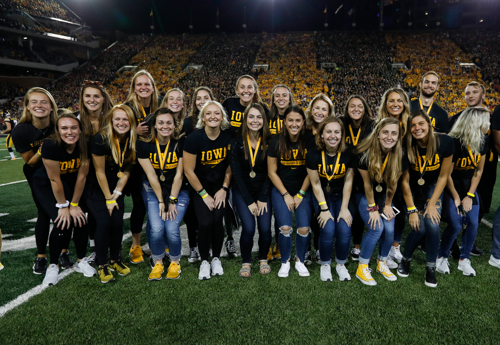 Members of the Iowa women's swimming and diving team are recognized by the Presidential Committee on Athletics at halftime during a game against Wisconsin on September 22, 2018. (Tork Mason/hawkeyesports.com)