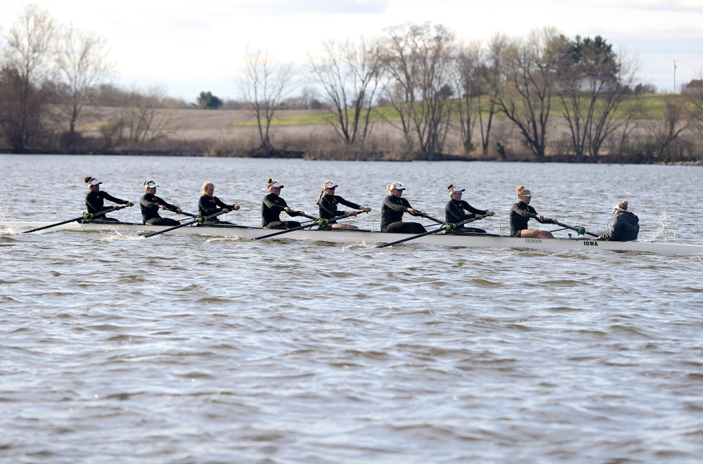 Iowa's Naomi Visser (from left), Elena Waiglein, Paige Schlapkohl, Hannah Greenlee, Hunter Koenigsfeld, Contessa Harold, Katie Pearson, Eve Stewart, and Logan Jones during their I Varsity 8 race against Minnesota in their Big Ten Double Dual Rowing Regatta at Lake Macbride in Solon on Saturday, Apr. 13, 2019. (Stephen Mally/hawkeyesports.com)