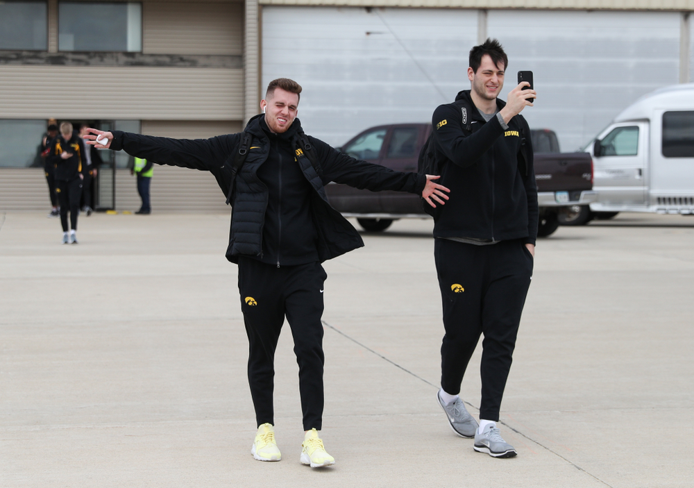 Iowa Hawkeyes guard Jordan Bohannon (3) and forward Ryan Kriener (15) board a flight to Columbus for the first and second rounds of the 2019 NCAA Men's Basketball Tournament Wednesday, March 20, 2019 at the Eastern Iowa Airport. (Brian Ray/hawkeyesports.com)