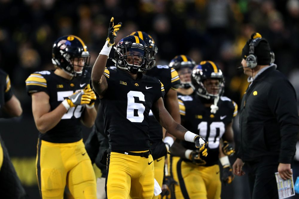 Iowa Hawkeyes wide receiver Ihmir Smith-Marsette (6) signals for a first town after a catch against the Northwestern Wildcats Saturday, November 10, 2018 at Kinnick Stadium. (Brian Ray/hawkeyesports.com)