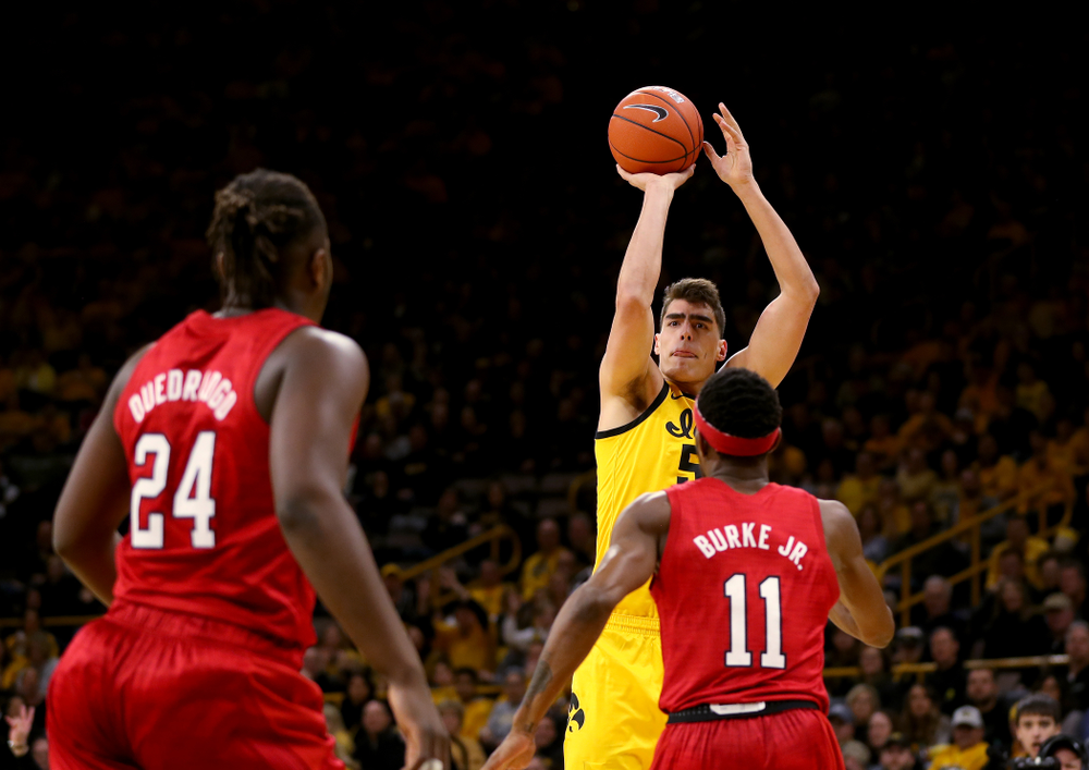 Iowa Hawkeyes forward Luka Garza (55) knocks down a three point basket against the Nebraska Cornhuskers Saturday, February 8, 2020 at Carver-Hawkeye Arena. (Brian Ray/hawkeyesports.com)