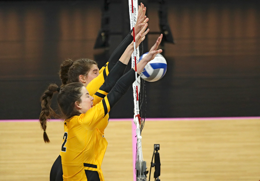 Iowa's Blythe Rients (11) and Courtney Buzzerio (2) block a shot during their match at Carver-Hawkeye Arena in Iowa City on Sunday, Oct 20, 2019. (Stephen Mally/hawkeyesports.com)