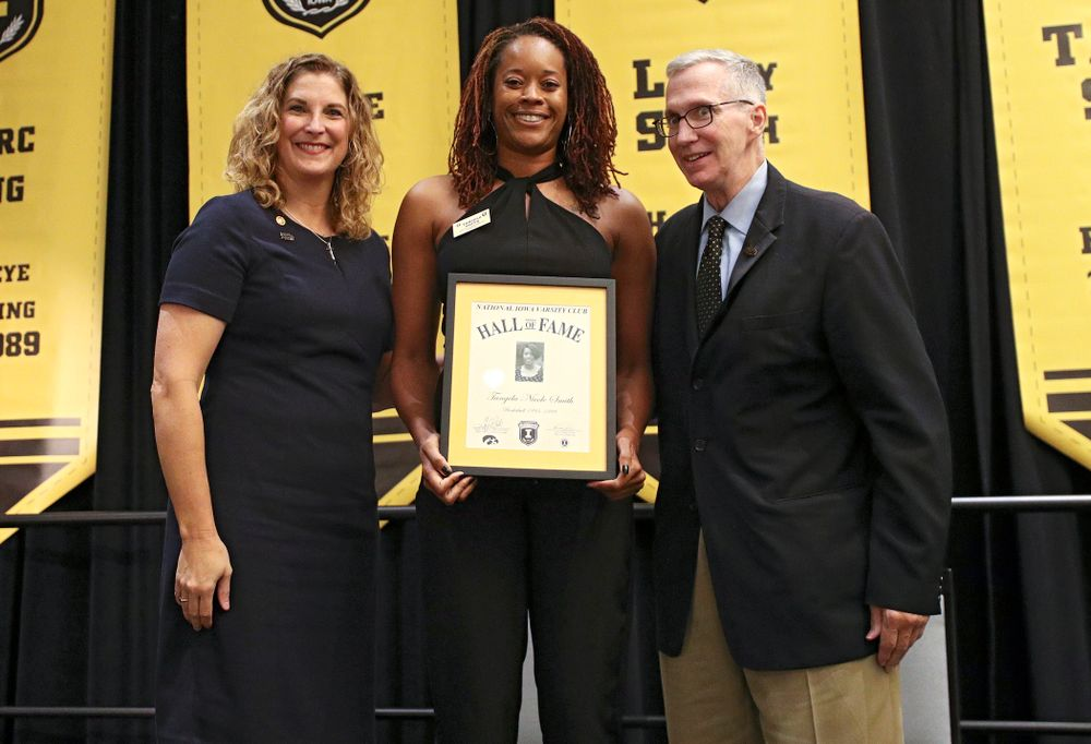 Barb Randall (from left), co-chair of the Varsity Club Advisory Committee, 2019 University of Iowa Athletics Hall of Fame inductee Tangela Smith, and Andy Piro, assistant athletics director and executive director of the Varsity Club, during the Hall of Fame Induction Ceremony at the Coralville Marriott Hotel and Conference Center in Coralville on Friday, Aug 30, 2019. (Stephen Mally/hawkeyesports.com)