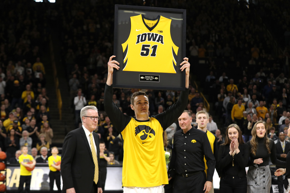 Iowa Hawkeyes forward Nicholas Baer (51) holds up his frames jersey during senior day activities before their game against the Rutgers Scarlet Knights  Saturday, March 2, 2019 at Carver-Hawkeye Arena. (Brian Ray/hawkeyesports.com)
