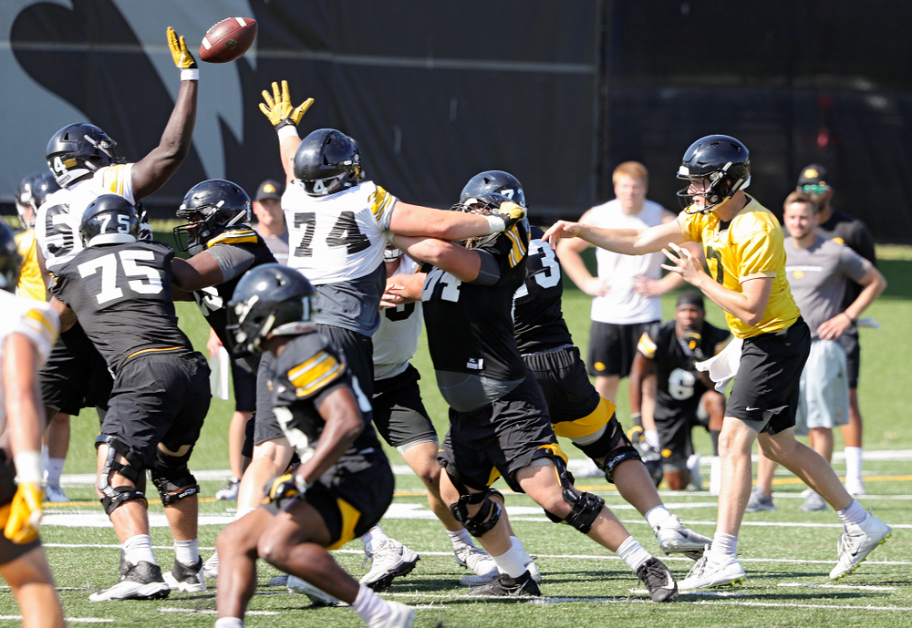 Iowa Hawkeyes defensive tackle Daviyon Nixon (54) tips a pass by quarterback Spencer Petras (7) during Fall Camp Practice No. 13 at the Hansen Football Performance Center in Iowa City on Friday, Aug 16, 2019. (Stephen Mally/hawkeyesports.com)