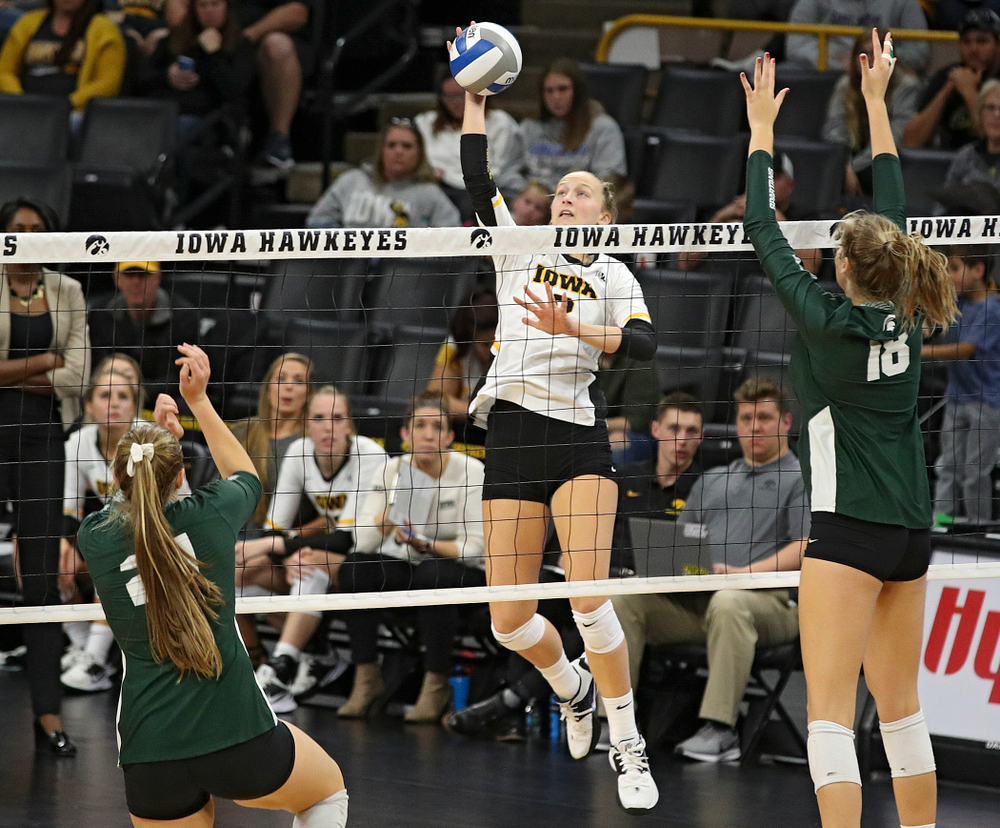 Iowa's Kyndra Hansen (8) lines up a shot during the fifth set of their volleyball match at Carver-Hawkeye Arena in Iowa City on Sunday, Oct 13, 2019. (Stephen Mally/hawkeyesports.com)
