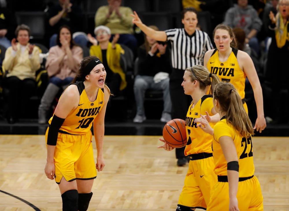 Iowa Hawkeyes forward Megan Gustafson (10) and guard Makenzie Meyer (3)