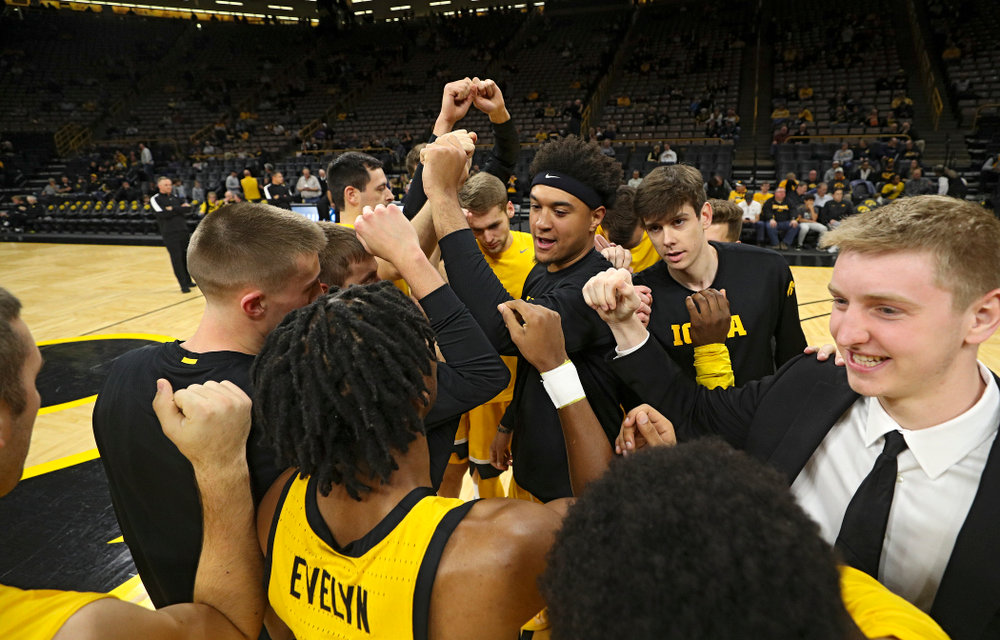 The Iowa Hawkeyes huddle before their game at Carver-Hawkeye Arena in Iowa City on Monday, Nov 11, 2019. (Stephen Mally/hawkeyesports.com)