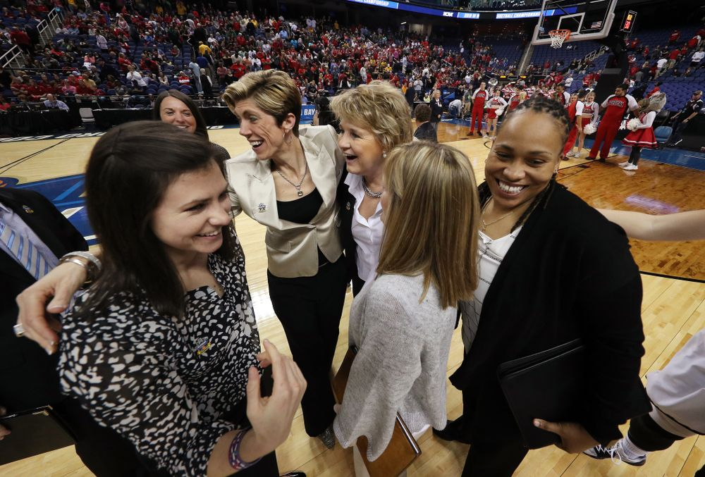 Iowa Hawkeyes head coach Lisa Bluder, associate head coaches Jan Jensen, and Jenni Fitzgerald, and assistant coach Raina Harmon against the NC State Wolfpack in the regional semi-final of the 2019 NCAA Women's College Basketball Tournament Saturday, March 30, 2019 at Greensboro Coliseum in Greensboro, NC.(Brian Ray/hawkeyesports.com)