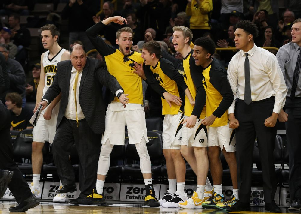 Iowa Hawkeyes forward Riley Till (20) reacts to a dunk by forward Tyler Cook (25) against the Ohio State Buckeyes Saturday, January 12, 2019 at Carver-Hawkeye Arena. (Brian Ray/hawkeyesports.com)