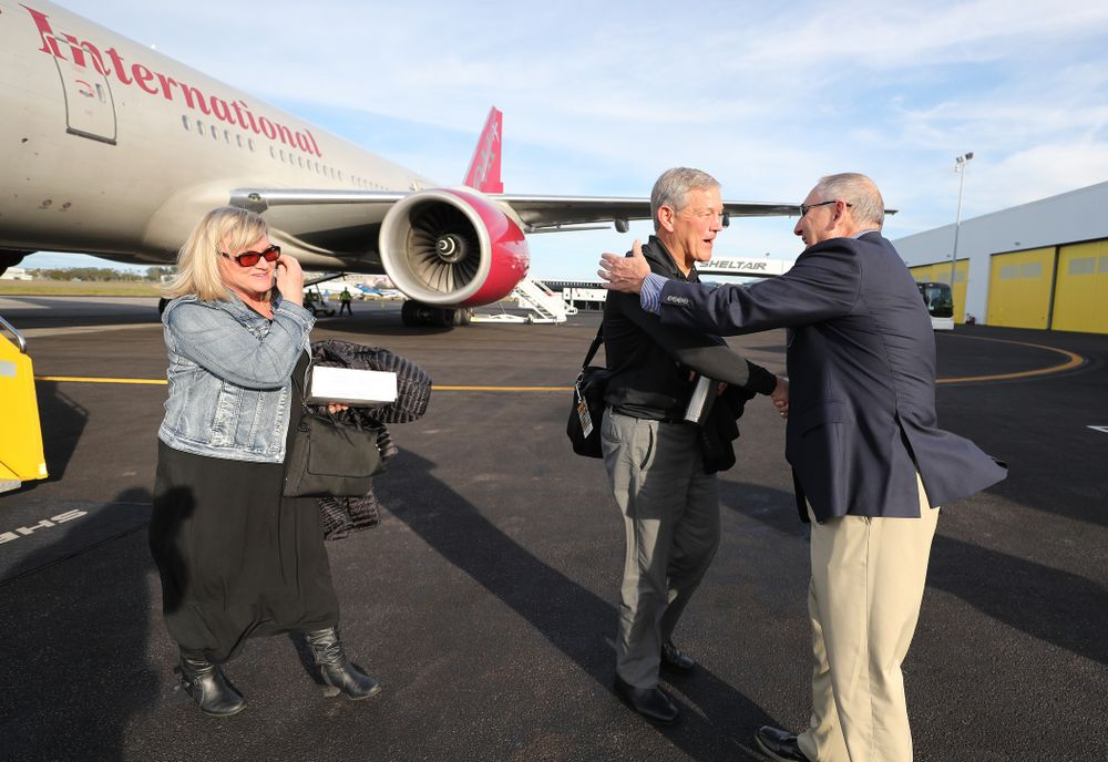 Iowa Hawkeyes head coach Kirk Ferentz shakes hands with Outback Bowl team host Bruce Poli Wednesday, December 26, 2018 as they arrive in Tampa, Florida for the Outback Bowl. (Brian Ray/hawkeyesports.com)