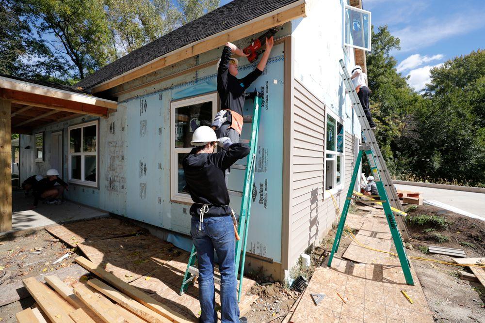 Iowa Hawkeyes forward Amanda Ollinger (43) works on the Habitat for Humanity Women's Build Wednesday, September 26, 2018 in Iowa City. (Brian Ray/hawkeyesports.com)