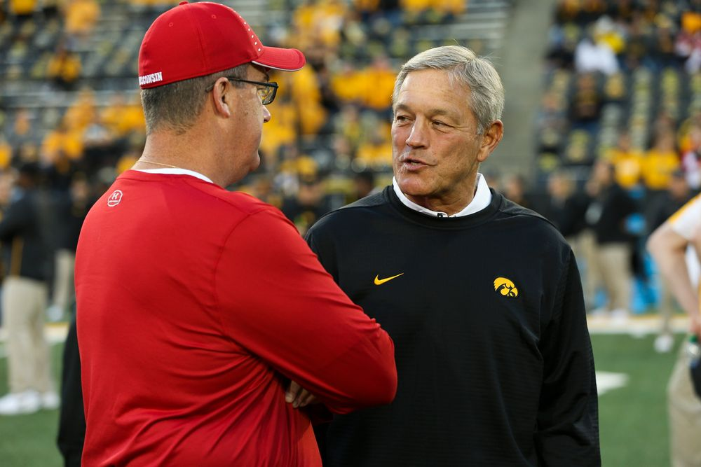 Iowa Hawkeyes head coach Kirk Ferentz meets with Wisconsin Badgers head coach Paul Chryst before a game against Wisconsin at Kinnick Stadium on September 22, 2018. (Tork Mason/hawkeyesports.com)