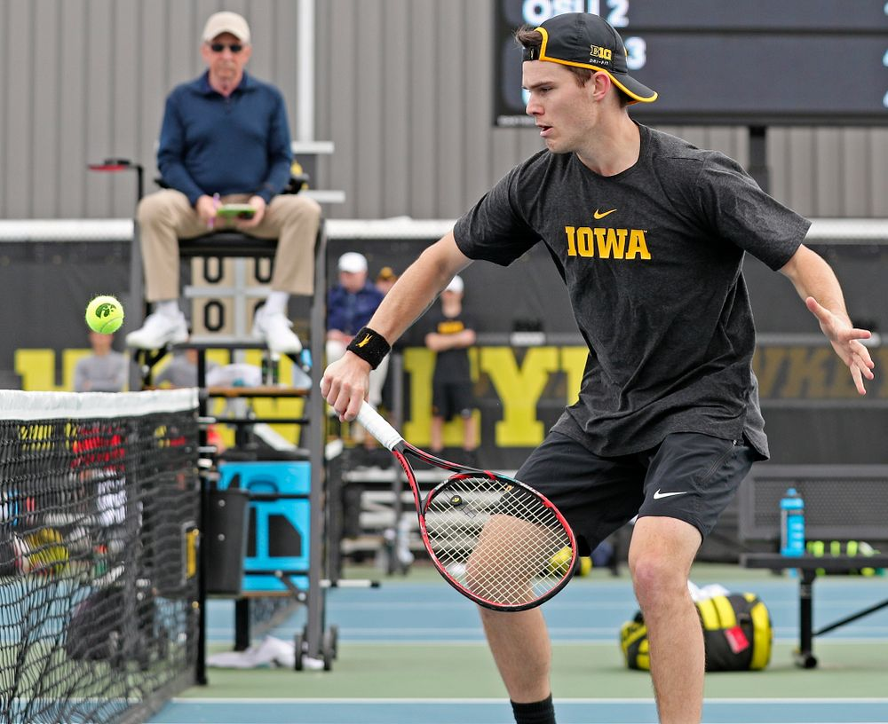Iowa's Jonas Larsen plays at the net during a double match against Ohio State at the Hawkeye Tennis and Recreation Complex in Iowa City on Sunday, Apr. 7, 2019. (Stephen Mally/hawkeyesports.com)