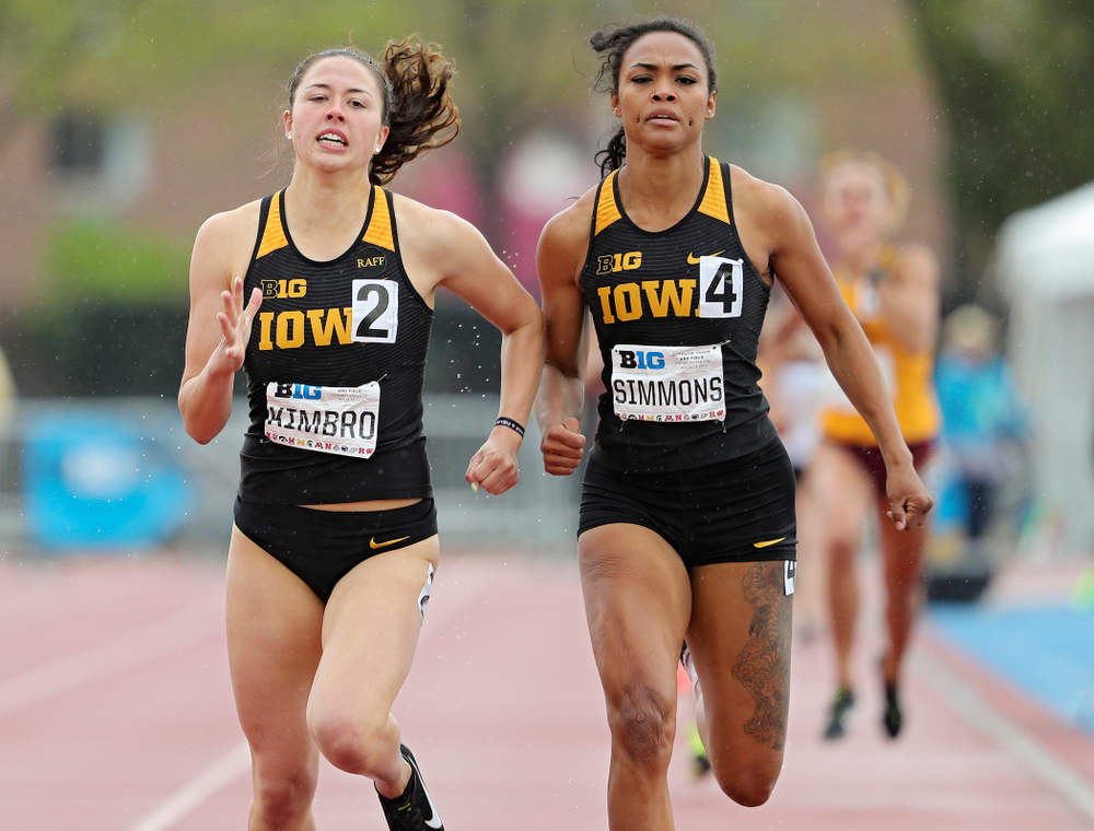 Iowa's Jenny Kimbro (from left) and Tria Simmons run in the women's 800 meter in the heptathlon event on the second day of the Big Ten Outdoor Track and Field Championships at Francis X. Cretzmeyer Track in Iowa City on Saturday, May. 11, 2019. (Stephen Mally/hawkeyesports.com)