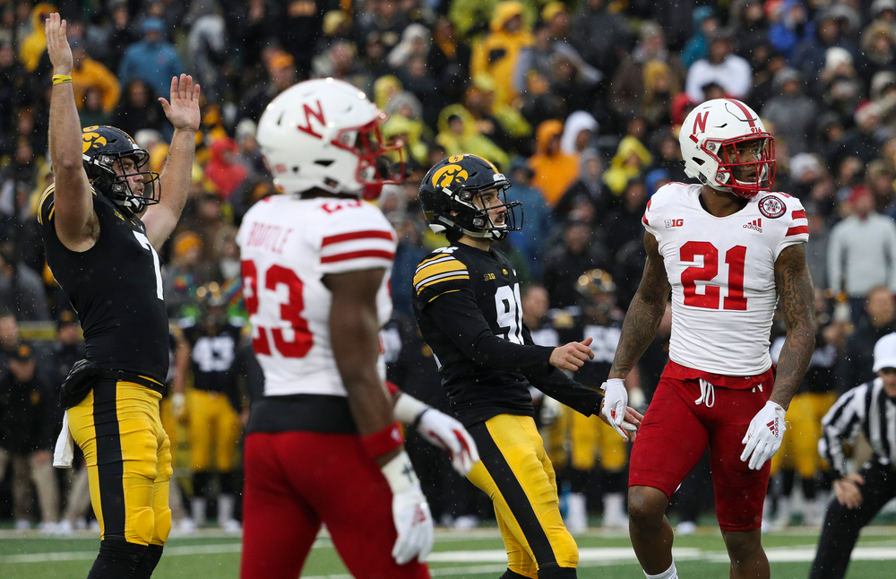 Iowa Hawkeyes punter Colten Rastetter (7) and Iowa Hawkeyes placekicker Miguel Recinos (91) watch as Recinos' game-winning 41-yard field goal as time expires during a game against Nebraska at Kinnick Stadium on November 23, 2018. (Tork Mason/hawkeyesports.com)